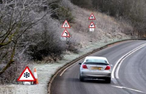 Motorists are being urged to take extra care on roads as the snow continues to fall