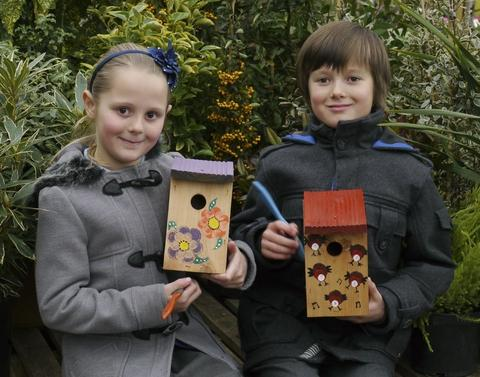 Grace Osborne, seven, and Harry Osborne, eight, ready for the nest box decorating workshop