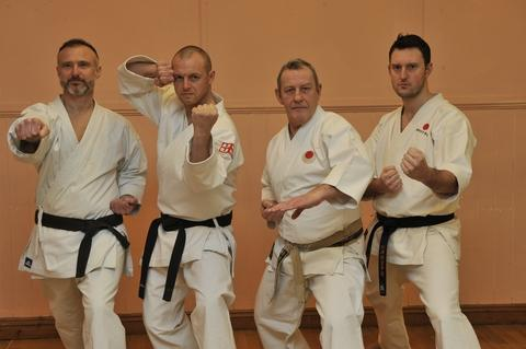 Perfect blend: Gary Envine, Jason Lester, Stuart Hughes and Bradley Holmes perform a kata.