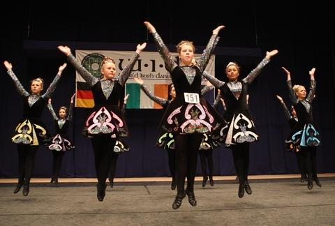 Performers showcase traditional Irish dancing.