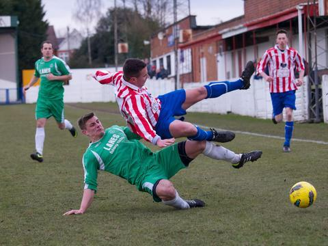 No mercy: Bromsgrove Sporting's Andy Nicol is sent flying following this crunching Coventry Copsewood tackle. Picture by Andre Roberts.