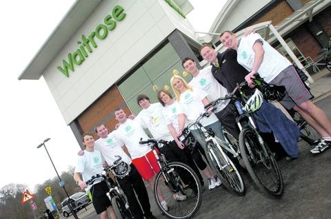 Staff from Droitwich's Waitrose store prepare for a cycle challenge.