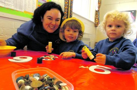 Nicki Marks, from Hadzor and Oddingley Pre-School, with youngsters Thomas Clay, three, and Emily Greenwood, two.