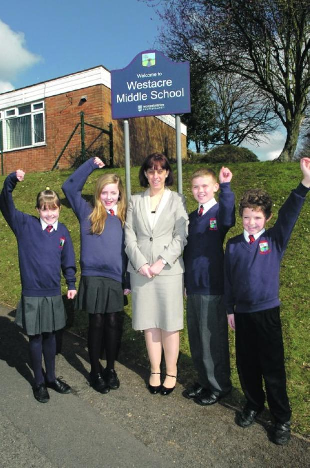 Headteacher Donna Evans with pupils Layla Heart, nine, Maddie Henn, 11, Simon Brownlee, 12, and Maxwell Clarke, nine.