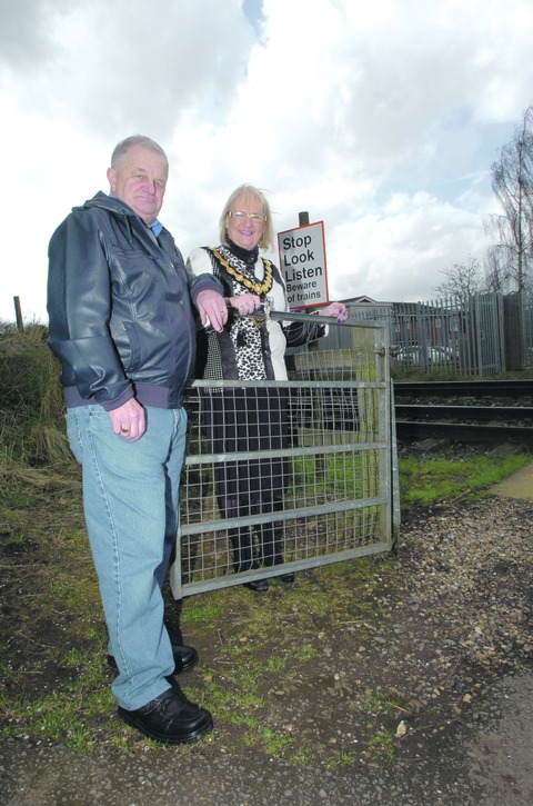 Mayor of Droitwich Spa, Councillor Anne Taft, with resident John Cook at the railway crossing.