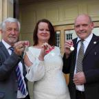 Charlie Nelson from Bromsgrove, Mandy Painter and Graham Houghton, both from Worcester, proudly hold their British Empire Awards outside Worcester's Guildhall following the ceremony.
