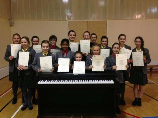 The pupils at Dodderhill School in Droitwich who have excelled in their music exams.