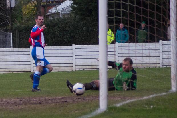 Droitwich Advertiser: Cool finish: Mark Bellingham fires home the first of his hat-trick. Picture: ANDRE ROBERTS