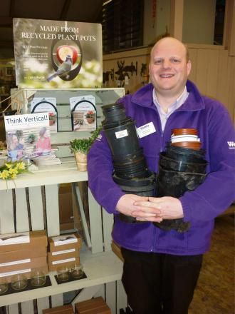 Will Haycock from Webbs garden shop with some of the pots ready to recycle.