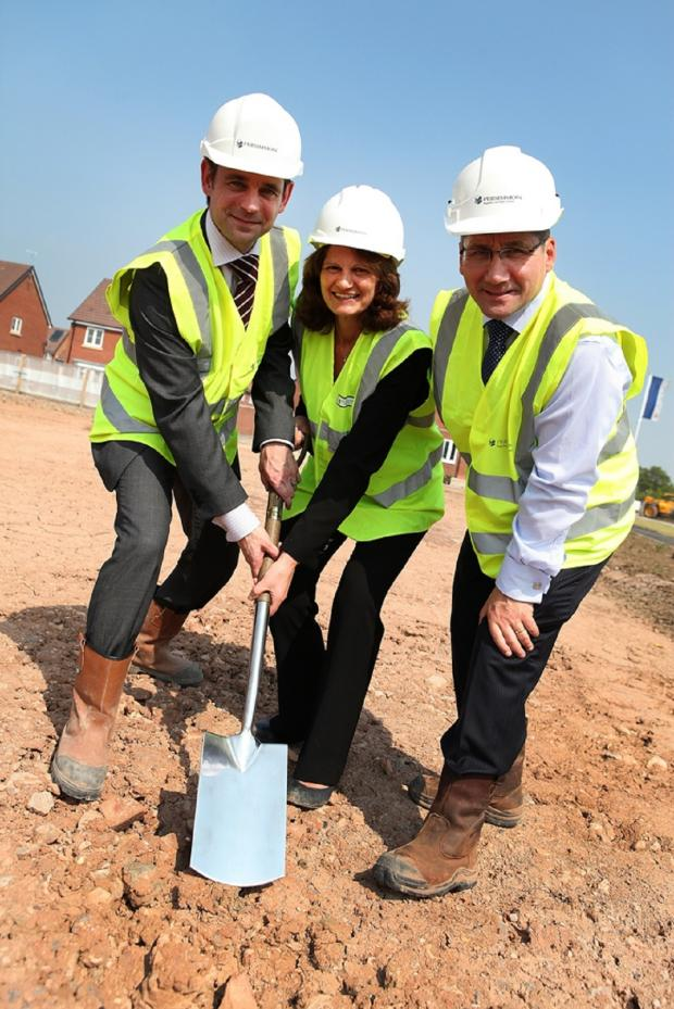 Droitwich Advertiser: NEW HOMES: Persimmon Homes South Midlands managing director, Richard Oldroyd, sales and marketing director Alison Reading and construction director Martin Howard at the site becoming Elmbridge Gardens. SP