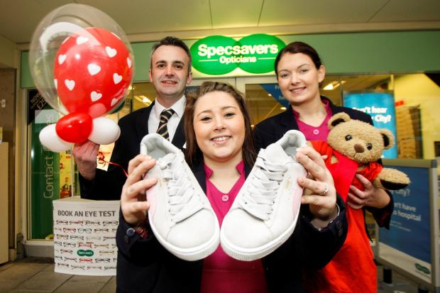 Ref. BCR061404  Specsavers staff member Chantelle Carroll is getting ready for a charity walk hoping to raise money for British Heart Foundation.  L-R -  Steve Perry -  Chantelle Carroll - Becky Muir -  (3762995)