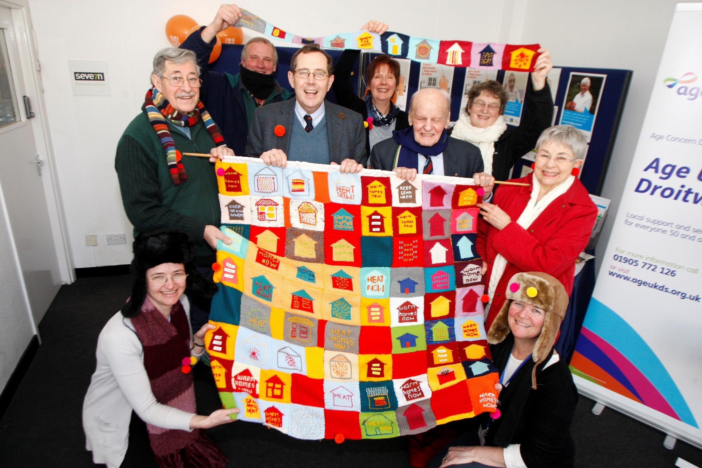 Ref. BCR071404  MP Peter Luff seen visiting Age UK to mark the efforts by Age UK volunteers for Age UK Warm Homes Week by creating a knitted square into a blanket. (3899245)