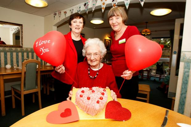 Ref. BCR071403  Westmead Residential Care Home are all wearing red to raise vital funds for the British Heart Foundation.  L-R -  Maureen Morse (Activities Co-Ordinator) -  Elise Tattersall (Resident) -  Margaret Willis (Domestic Supervisor) -  (3899237)