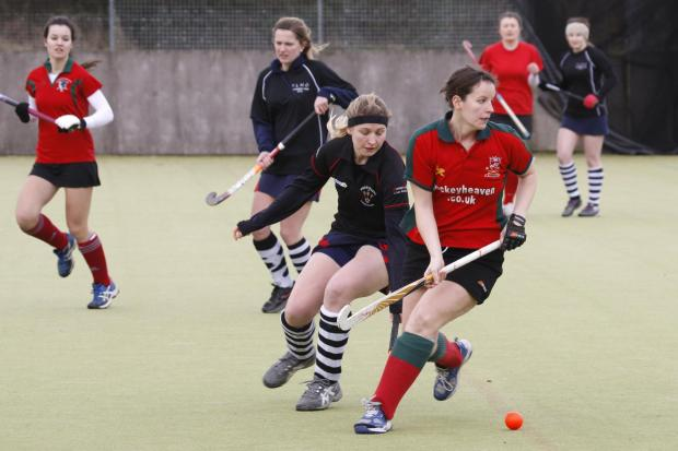 Bromsgrove Ladies (red) in action against Tenbury. Picture: CRAIG ROSS