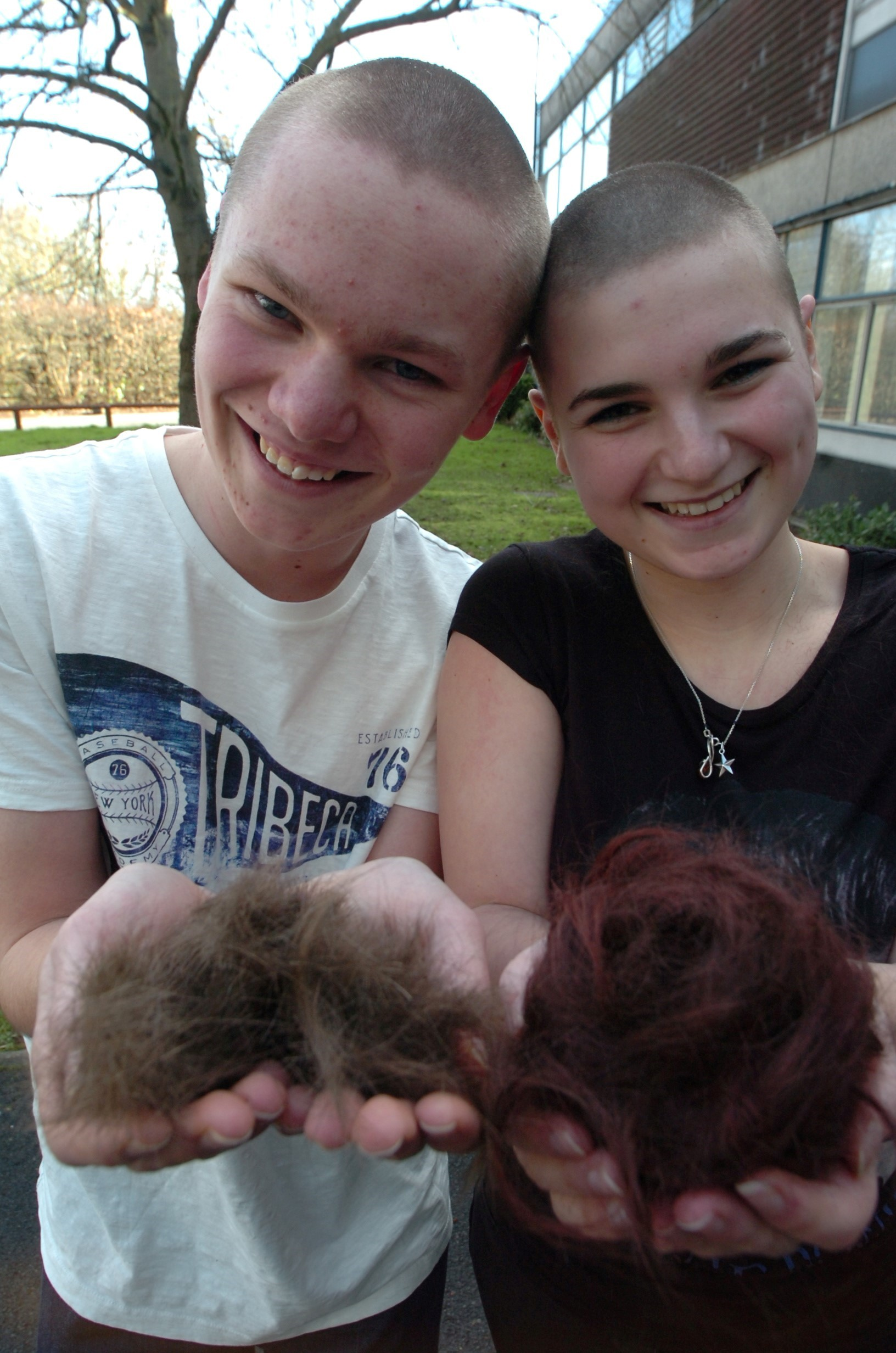 Students shave their heads for cancer charity