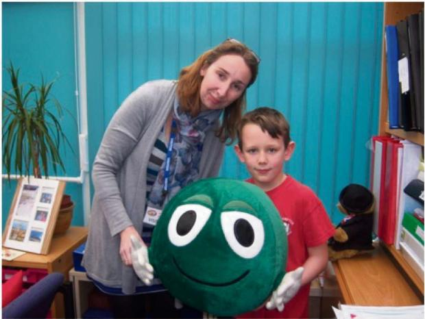 Kia Giles, from the NSPCC, with pupil Cameron Jones who raised the largest amount of sponsorship, and Buddy, the NSPCC mascot.