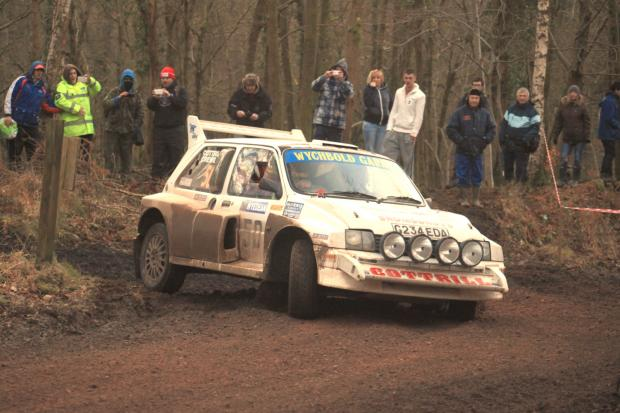 Torrential rain slows rally pair