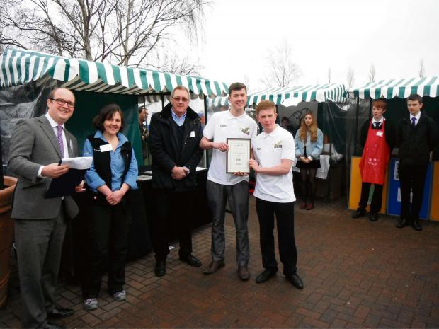 North Bromsgrove students Chris Bishton and Tom Andrews of Hashtag Reco from North Bromsgrove High with their award for sales and marketing at last year's event, with (from left) Webbs chairman Ed Webb, Jo Courtney, from Cotswold Outdoor, and Neil H