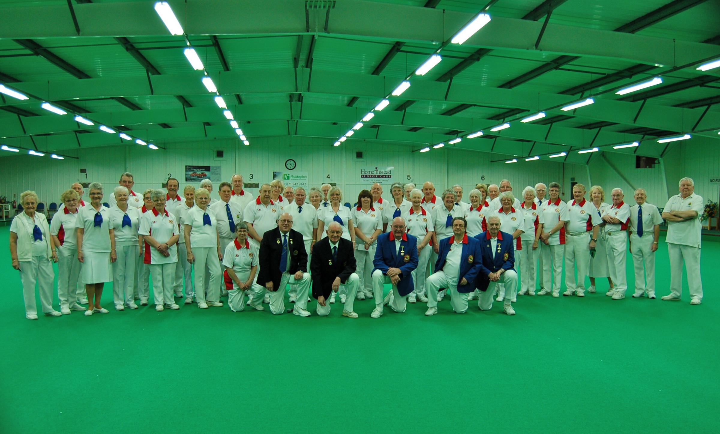 A match to remember: Members of Bromsgrove Indoor Bowls Club with some of the England team they played last week.