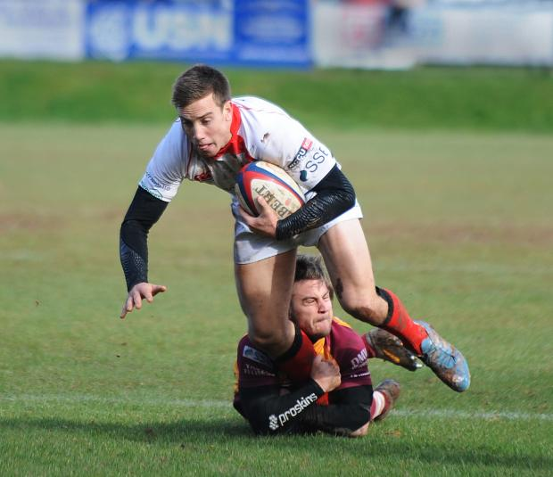 Effective display: Elliott Davies is tackled by a Sedgley Park player.  Picture: PETE JEPSON