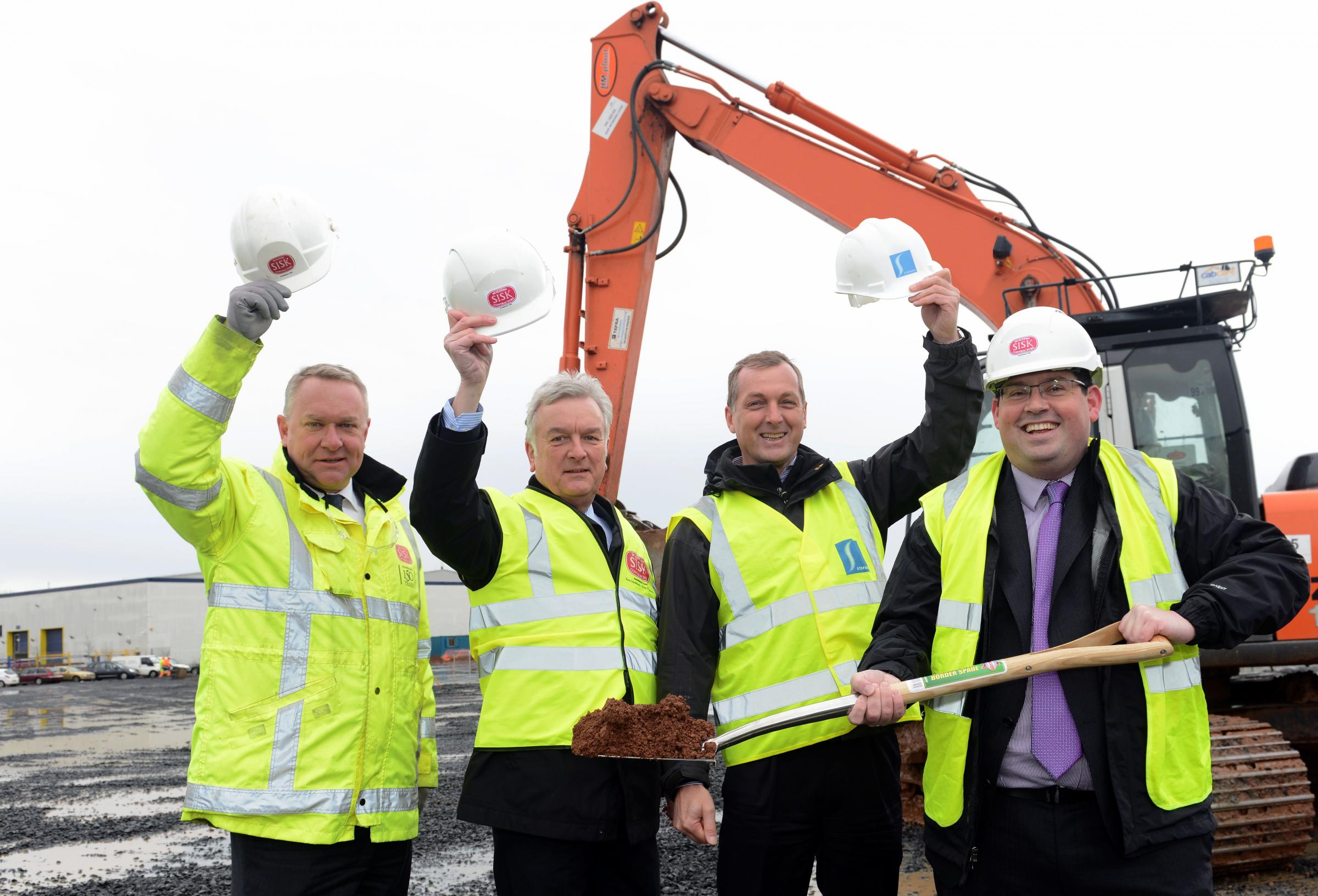 Kim Shevyn from John Sisk & Son with Stephen Yates from AXA, David Brown from Stoford, and John Upperton from Vax cutting the first sod of the new building. SP