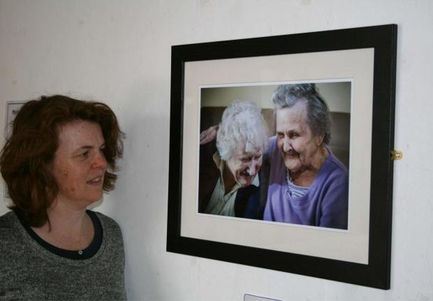 Jenny Davis, arts development officer at Wychavon District Council, admires one of the photographs in the exhibition. SP