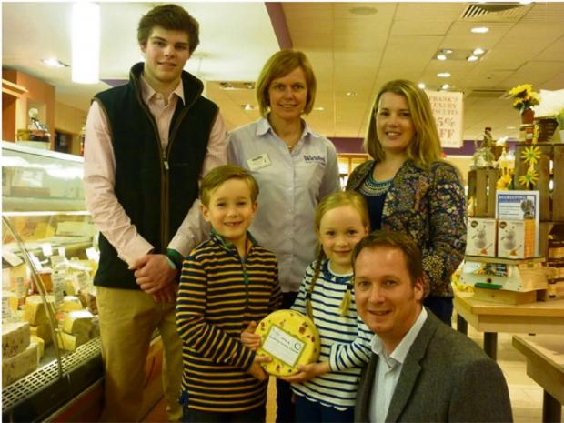 Droitwich Advertiser: Harry Hodgetts from Croome Cuisine, and Victoria Peacock from Webbs food hall, with Guy and Helen Jackson and their twins William and Amelie proudly holding their new cheese. SP