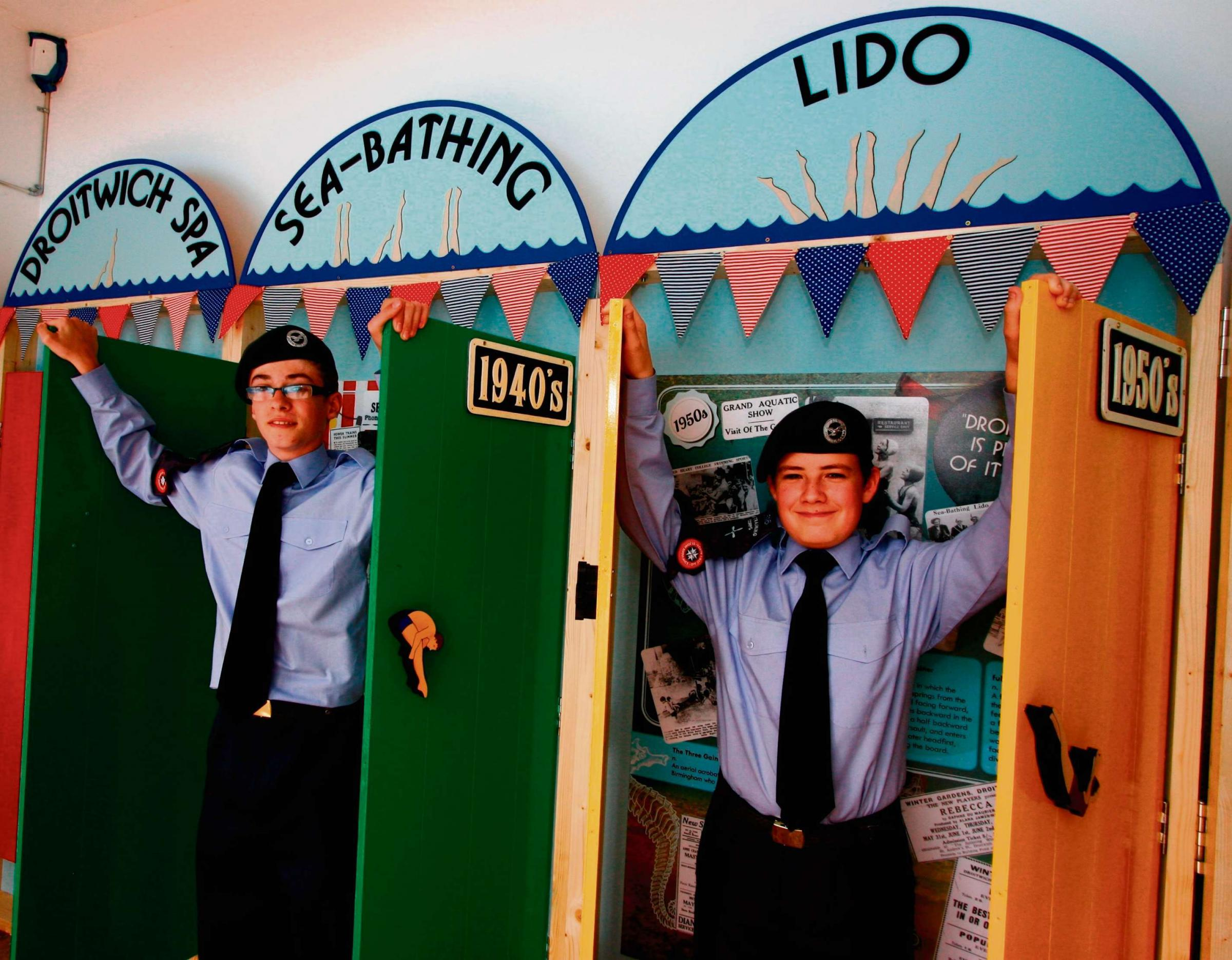 Sam Cooper and Gwyndaf Wheeler of the Droitwich Air Cadets with the exhibition at the Lido. sP