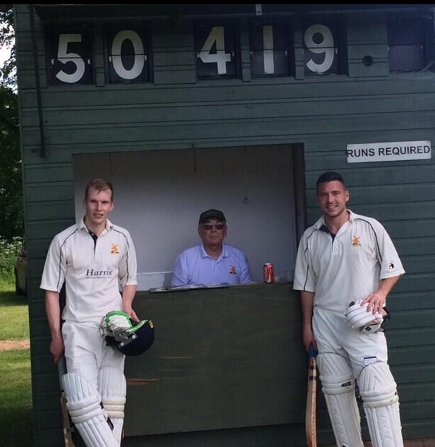 RECORD BREAKERS: Andy Nicol (left) and Will Sach stand by the scoreboard after their brutal 419-run opening partnership for Avoncroft.