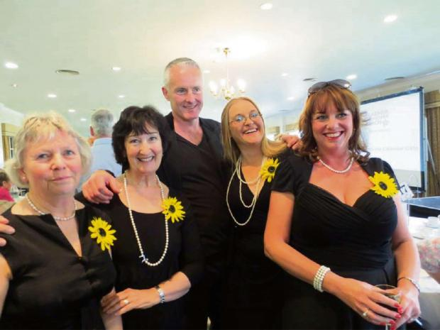 Some of the Norbury's calendar girls with writer Tim Firth. SP