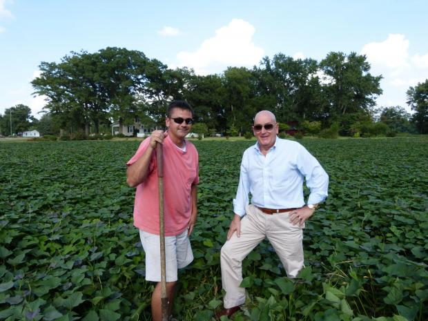 Dewey Scott with a co-worker on his North Carolina farm. SP