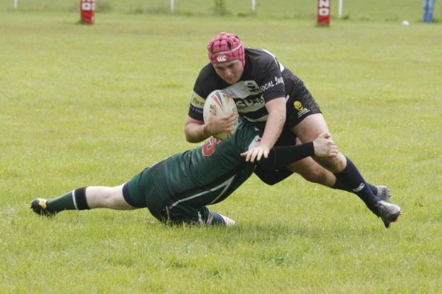 Droitwich Advertiser: A Ravens player is tackled during Saturday's home defeat to Derby City. Picture: CRAIG ROSS