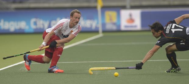 Droitwich Advertiser: Dan Fox in action for England at the Hockey World Cup.