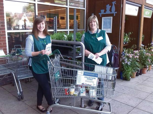 Beth Plumptre and Karen Philips  help collect donations at Waitrose. SP
