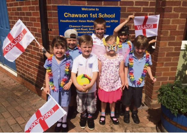 Getting into the carnival spirit with a Brazilian summer fayre at Chawson First School. SP