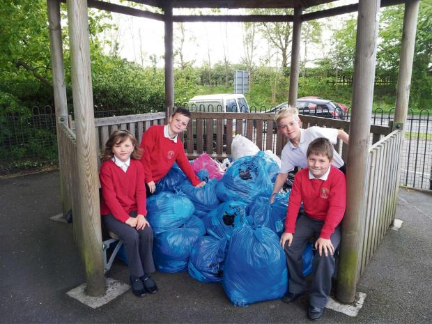 Year four students Elena Troth, Corey Bagnall, James Gregory and Zander Marshall show off some of the clothes the school has collected. SP