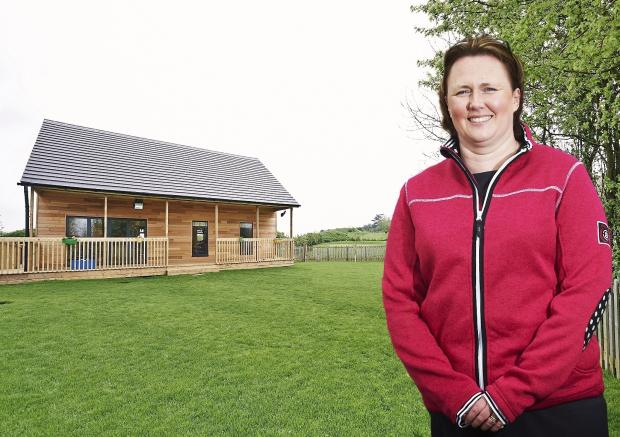 Phoenix owner Jenny Fernihough outside the new lodge. Image courtesy of Daniel Graves Photography. SP