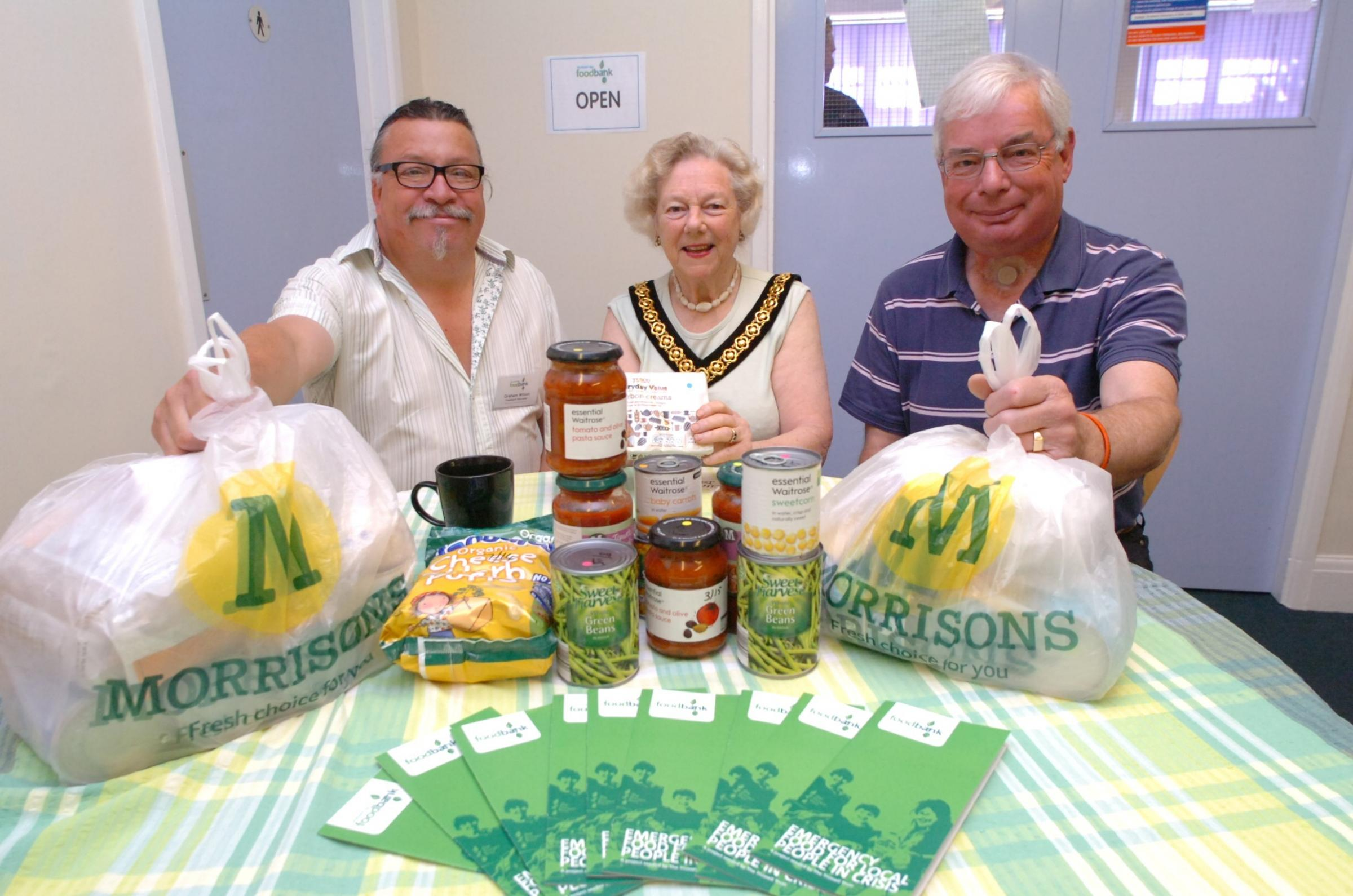 Project leader Graham Wilson, chairman, Councillor Pam Davey, and project manager David Stanbury at the launch of the Droitwich Spa foodbank. Buy photo: BMM281402 at droitwichadvertiser.co.uk/pictures or call 01384 358200.