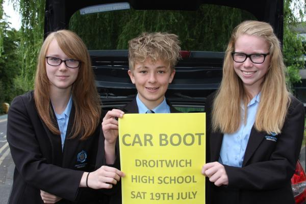 Holly Eaton, George Townson and Emma Preece get ready for the car boot sale. SP