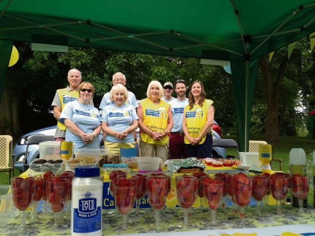 The fundraisers at their picnic in the park stall. SP