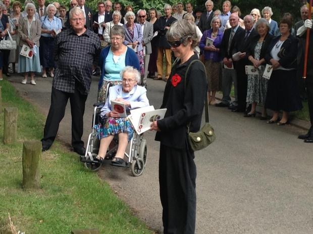 Peggy Dovey with other members of the Dovey family, and a relative of the Hartland family with the poppy. SP