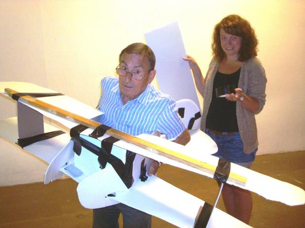 Mike Matthews and Liz McCabe prepare a prototype model of a Tiger Moth for a dramatic chase across the Scottish moors. SP
