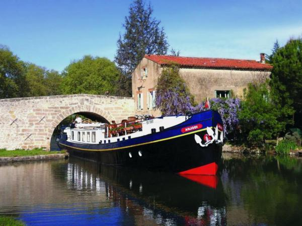 CALM CRUISE: Enjoy the tranquility of a barge hotel such as the Anjodi on a holiday in France.