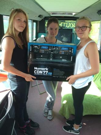 Nicole Merchant, Chloe Weston, and Madi Rouse  on the Youth Bus with the new music equipment. SP