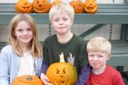 Flora, Archie and Billy Webb with their pumpkins. SP