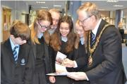 Mayor Bob Brookes, shows off the calendar to students at Droitwich Spa High School (from left): Nikita Hennessey, Amy Merryweather, Bethanie Martin and Max Wrigley. SP