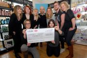 4914770401. 02/12/14. Manager of Jon Quality Hair in Malvern Link, Steve Surridge, fourth from left with his team of stylists who raised £511 for Breast Cancer Research by holding a charity open night last month. Picture by Nick Toogood. (13878917)