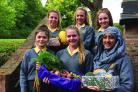 GENEROUS: Pupils Amy Tomkinson, Hannah Lee, Nazia Ahmed, Isabel Pudney, Rebecca Lee and Brian Cull with the produce they collected.