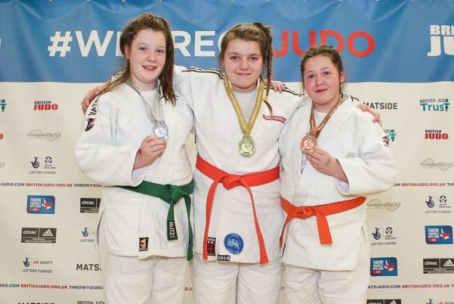 Droitwich Spa Judo Kan student Megan Skillern (left) won a silver medal at the British Schools Championships, with team-mates Helena Harvey and Chloe Baker.