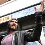 Droitwich Advertiser: Russell Brand gives his east London cafe to charity